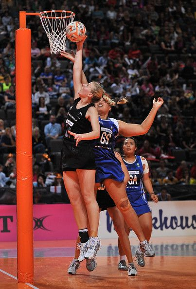 Katrina Grant of New Zealand stops Monica Fuimaono of Samoa during match 13 of the World Netball Series between Samoa and New Zealand at the MEN Arena on October 10, 2009 in Manchester, England.