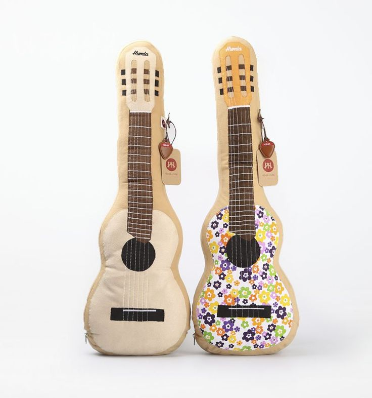 Guitalele Cushion Cream and Brownby Humia Living. A perfect and adorable cushion to decorate your room feature 2 cushion in guitar shaped. A set of cushion in cream and browncolor and each of cushion has size dimension:60cm x 22cm x 14cm.  http://www.zocko.com/z/JKBL1