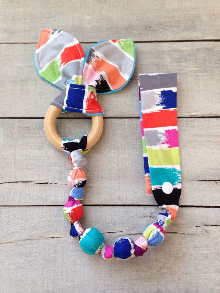 Cartwheel Tula Accessory, Snap teether, Brush Stroke fabric teether, Tula snap on teether, fabric teething ring, car seat toy, wood teether by TheTeethingFairy on Etsy https://www.etsy.com/listing/244187249/cartwheel-tula-accessory-snap-teether