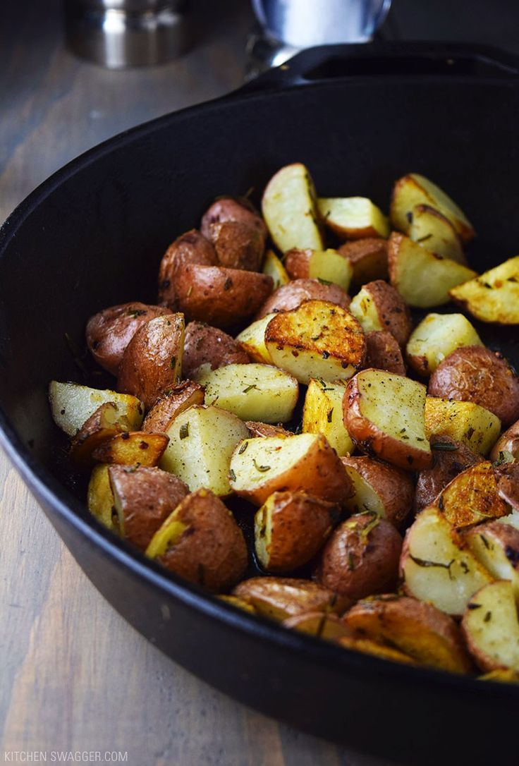 Roasted red potatoes tossed in rosemary, garlic, and olive oil and baked in a cast iron skillet.