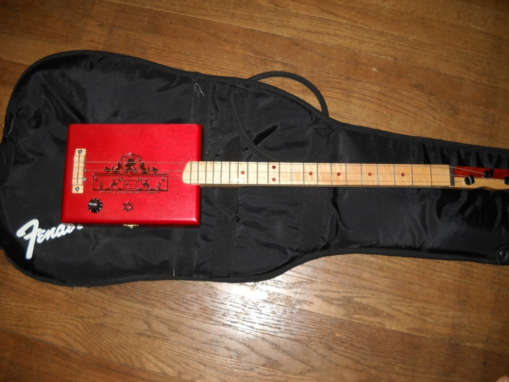 Very cool cigar box guitar made by my husband for Sarah