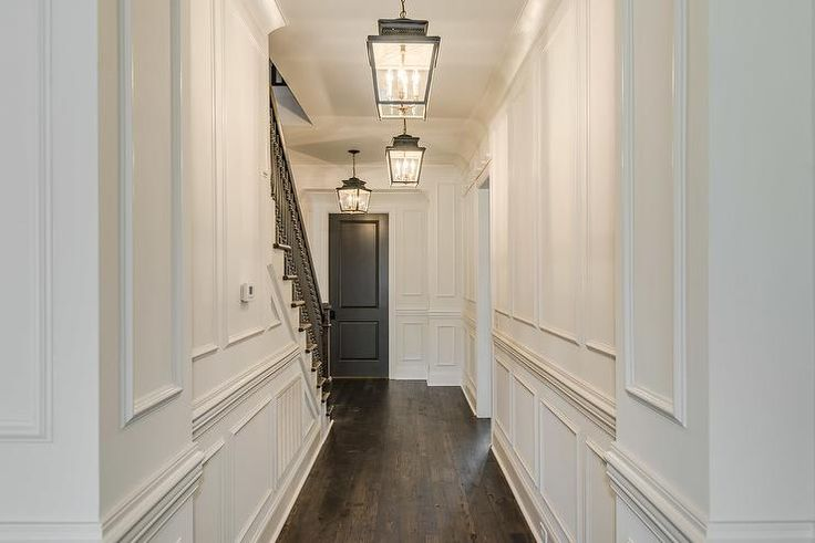 white-full-wall-wainscoting-foyer-black-front-door-carriage-lanterns.jpg (740×494)