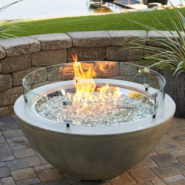 The Cove Propane Fire Pit Table is the perfect addition to any contemporary outdoor space. The natural gray supercast concrete bowl lets the focus be on the crystal fire burner. The organic natural appearance of the concrete is unique to each fire bowl and color variations, pitting and wear are common attributes to the beauty of the fire bowl.