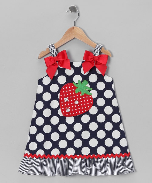 Every detail on this dress from the satin bows to the rhinestone-embellished strawberries was thoughtfully created with love. Stretchy shoulder straps, a button at the neck and tie in back were inspired by little wigglers and tiny twirlers. Dress: 100% cottonLining: 100% polyesterMachine wash; tumble dry