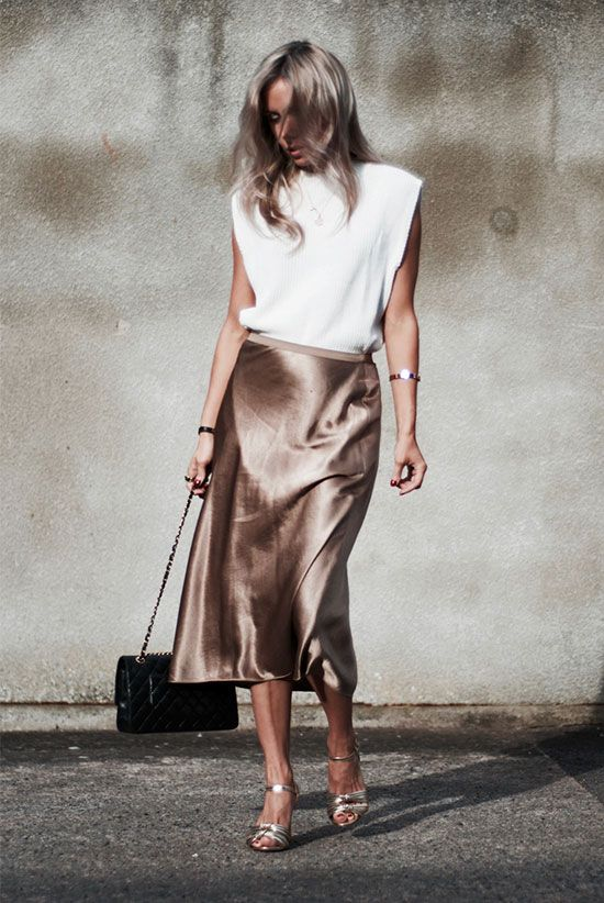 White geometric sleeveless top, a metallic midi skirt, metallic heels and a blac…