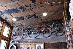 A collection of old steering wheels becomes instant eye candy when layered. Visit more man cave decorating ideas by Funky Junk Interiors for #eBay