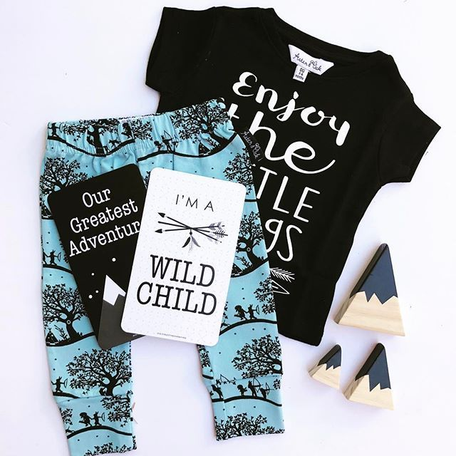 N E W • Introducing the seriously cool Enchanted Fields leggings & Essential 'Enjoy The Little Things' black tee by @aster_and_oak paired with monochrome @milestonesandmayhem baby milestone cards & @_tinytimber Mountain Peak blocks 🖤💙 Leggings, Tee & Milestone cards available now #linkinbio 👆🏻