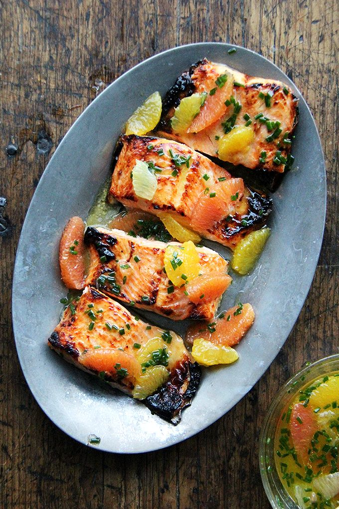 Broiled Lemon-Honey Arctic Char with Citrus Sauce // A mix of oranges and lemon, dress them with a small amount of olive oil and chives, and season with salt. The char is briefly marinated in a mix of equal parts citrus juice (stolen from the aforementioned sauce), olive oil, and honey. In five minutes under the broiler, these fillets are cooked through, ready to receive a citrus bath. // @alexandracooks