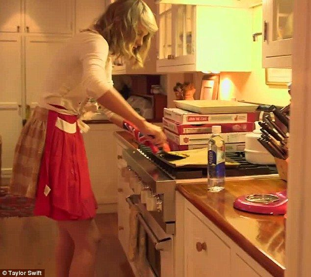Domestic goddess: In a behind the scenes clip, the singer could be seen baking cookies in her Los Angeles kitchen ahead of the first session