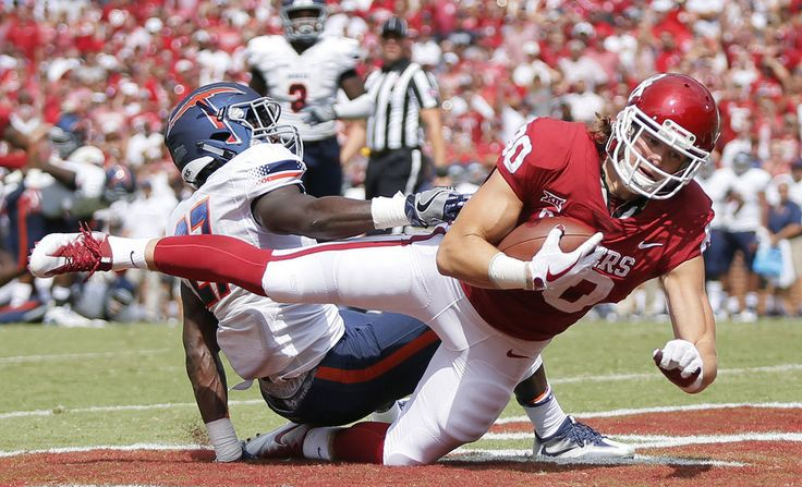 Oklahoma's Grant Calcaterra (80) makes a touchdown catch as UTEP's Devin Cockrell (27) defends in the second quarter during a college football game between the Oklahoma Sooners (OU) and the University of Texas at El Paso Miners (UTEP) at Gaylord Family-Oklahoma Memorial Stadium in Norman, Okla., Saturday, Sept. 2, 2017. Photo by Nate Billings, The Oklahoman