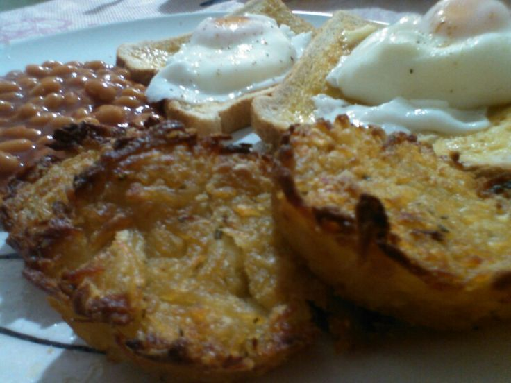 Long Weekend Big Breakfast - Home made potato, onion & parsley rostis, poached eggs on toast, baked beans.