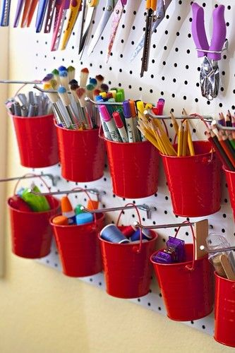 Peg board for stationery organisation -yoi could replace the buckets with recycled cans