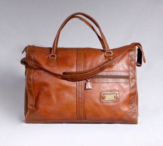 A beautiful 1970s 100% leather travel hand luggage. Real leather lined interior with several useful storage compartments. -- This seller has sooooo many beautiful bags I'd like to buy for my own closet, but they deal in fur. :(