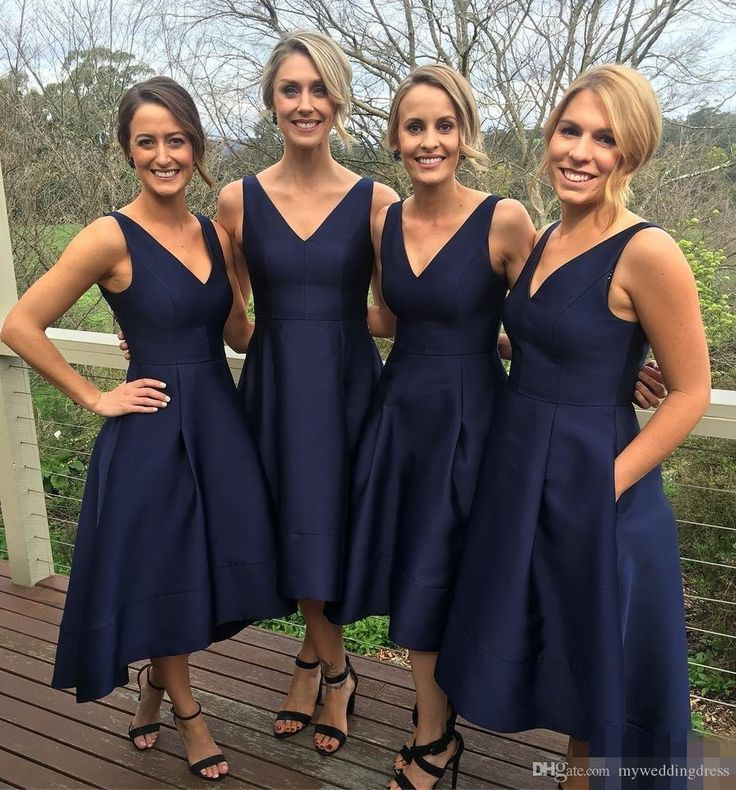 Fabric:Satin Neckline:V Neck Color: Navy Blue Length: Tea Length Sleeves:Sleeveless Skirt: High Low Skirt Back Detail:Zipper Back Silhouettes: A Line Collection: Prom , Formal , Homecoming   $147