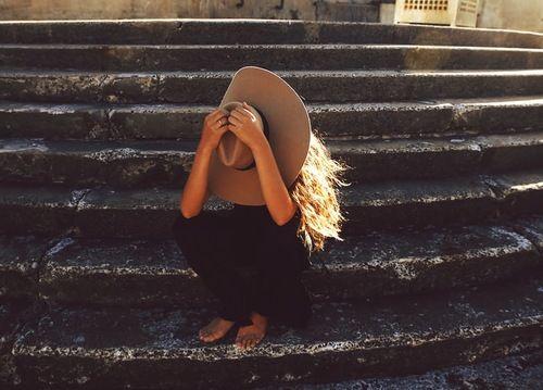 Stone steps, fedora hat, wavy hair