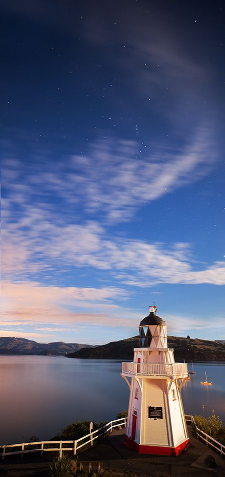 """""""Stars shine and the moon lights up the old lighthouse at Akaroa"""""""