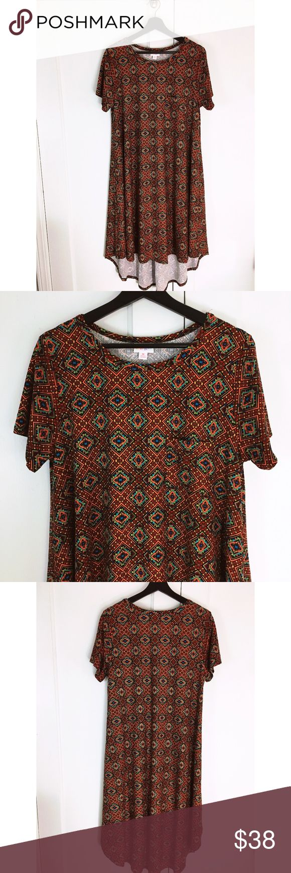 Lularoe Carly Hi Lo Tribal Aztec Print Dress Sz M Lularoe Carly Dress Aztec / Tribal / Southwestern Print  Chest Pocket High Low Hem  Made of 92% Polyester and 8% Spandex Super Soft -  Care instructions -  Hang to dry - NO DRYER Size Medium Bust is approx 19 inches measured flat Length is approx 44 at the longest point In excellent preowned condition - no sign of wear , no flaws - like new. LuLaRoe Dresses High Low