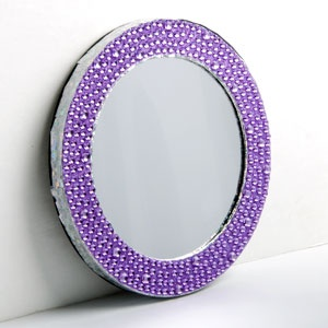 "MAGNETIC LOCKER MIRROR - PURPLE  Product # ZB21329  $7.98 CAD - Functional locker accessories don't have to be boring! Add some glitz and glam to your space with a glitter mirror has a magnetic back for easy hanging. 6"" Diam."