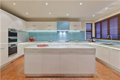 lighted glass back splash  Spare Contemporary Kitchen by Mal Corboy