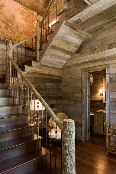 Barnwood wall paneling, log stair railing