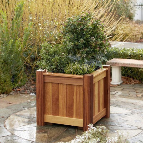 A square wooden planter made from quality Iroko wood, the perfect design for small trees and shrubs. Custom orders available at Taylor Made Planters.