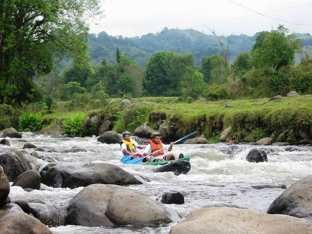 Rafting in a river of the Coffee Triangle Region in Colombia
