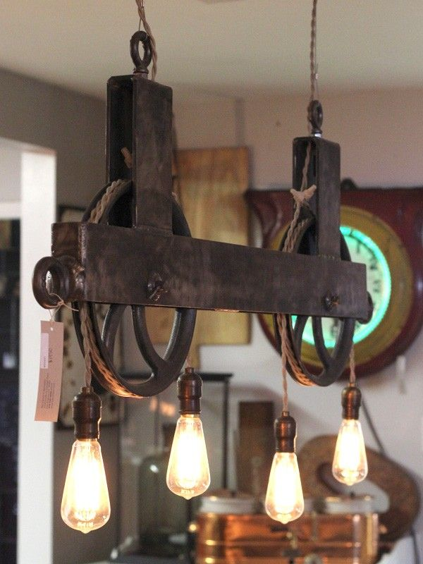 Double Pulley Light. Anyone know where to get that pulley system? Upcycled? Lighting ideas at www.pinterest.com/thebulbgarage/idea-board/ Edison bulbs at www.thebulbgarage.com #edisonlightbulb #vintagelightbulb #retrolighting