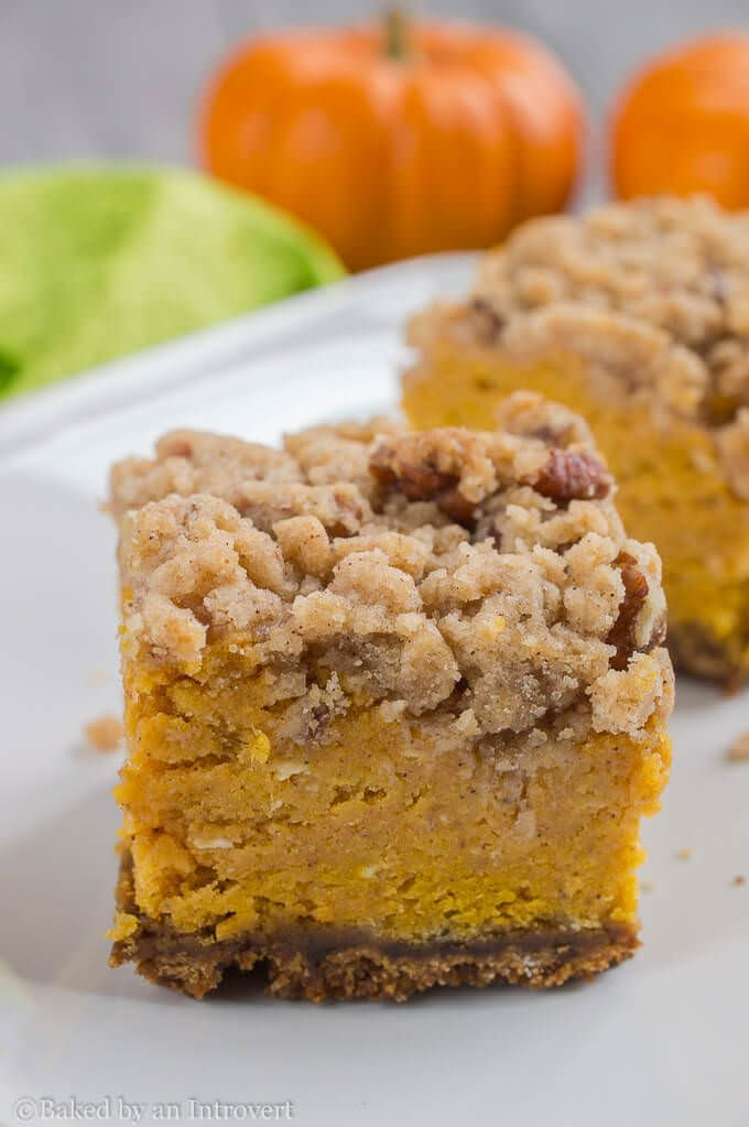 Thick Pumpkin Crumble Bars - Thick pumpkin filling layered over a ginger snap crust, and topped with a brown sugar pecan crumble.