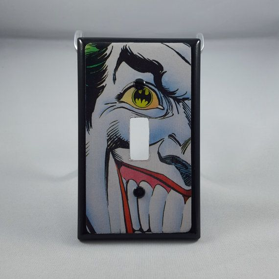 Handmade light switch covers featuring badass images from your favorite comic books.  Can be found on Etsy.  dailycoaster.com Joker Batman DC Comics Comic Books