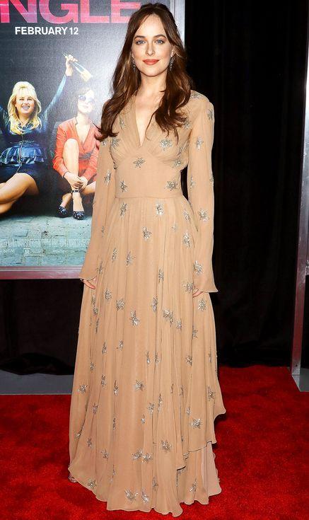 Dakota Johnson in a star-print peach gown