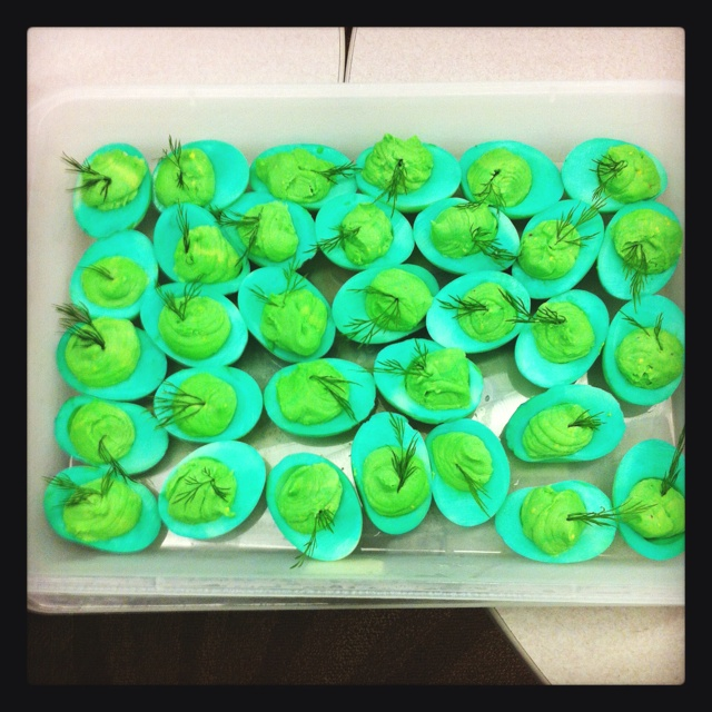 St. Patty's deviled eggs using green food coloring and green food spray!