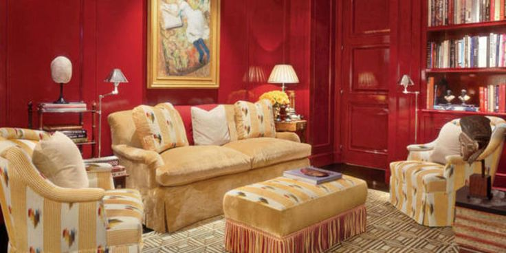Rich hues on the walls of this Manhattan abode serve as a background for the owners' extensive art display. Pastel by Edgar Degas. Sofa, chairs, ottoman and pillows, all by Bustamante, in Manuel Canovas velour and Colony stripe; Galón fringe. Other pillows in Rubello fabric. Custom floor lamps. Stark rug. INTERIOR DESIGN BY LUIS BUSTAMANTE