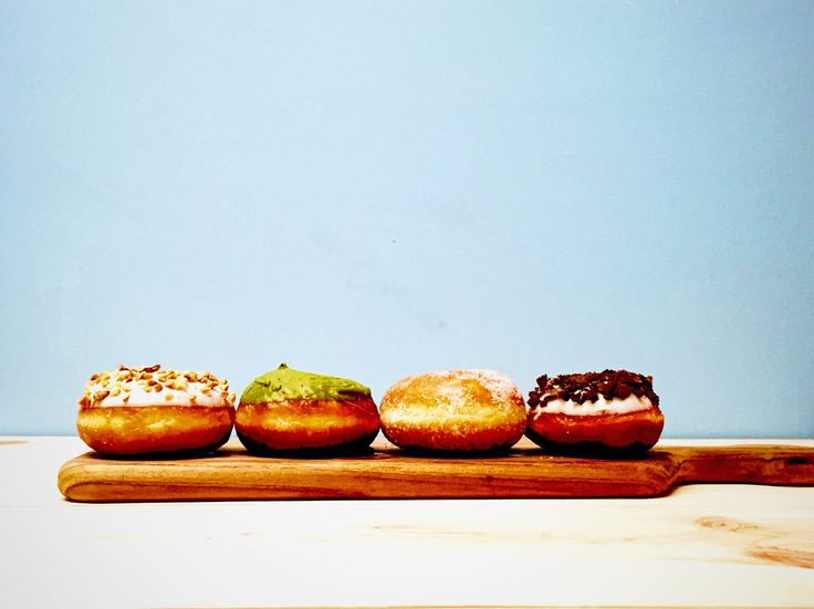 Colorful donuts. White chocolate, matcha green tea, sugar, crunch