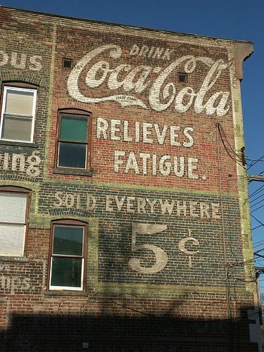 Aged advertisements on the city's buildings give the city of Syracuse character.:
