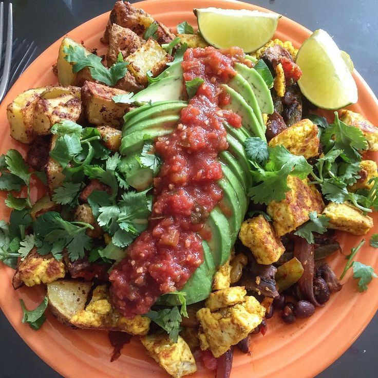 Brunch at our casa today is my version of a #veganbowlattack breakfast bowl. Roasted potatoes with nooch and chipotle powder, black beans and fajitas veggies with @rancho_gordo stardust chili spice, tofu scramble, avocado and salsa. I need the avocado shortage to end! #vegan #whatveganseat #tofuscramble #potatoes #avocado