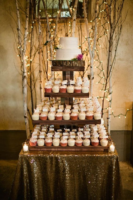 Rustic wedding cake + cupcake tower / http://www.deerpearlflowers.com/twigs-and-branches-wedding-ideas/