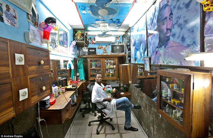 Hair idols: Much like anywhere else, many of the hairstyles requested in Africa are influenced by musicians and sports stars. This is apparent from the giant picture of Tupak Shakur in this Ivory Coast barbers