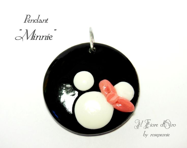 """Minnie"", pendant with design in low-relief ,made entirely by hand from molding to varnishing. Minnie's stylised silhouette, with the adorable pink bow, makes this the ideal accessory for girls who love pretty things, while its shiny black background adds style and the possibility to match it wi..."
