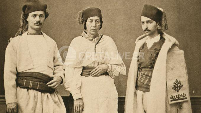Κρήτες με παραδοσιακές φορεσιές απ' τα Χανιά και τα Σφακιά, στα 1873