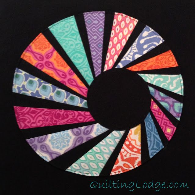 Quilting Lodge Blog: Swirly Twirly Dresden A lovely off centre block.  i love it.