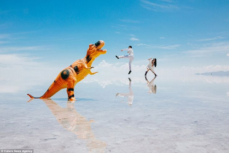 This surreal photograph taken by Ekaterina Mukhina shows a couple dressed in white attempt...