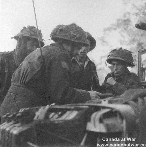 D-Day, Juno Beach - North Shore Company Commander briefs his officers.