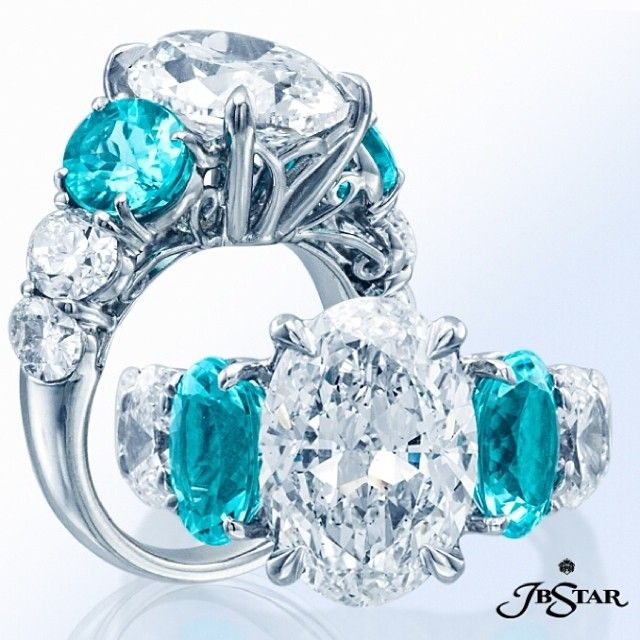 JB Star oval diamond center, two beautiful paraiba oval sides and four oval diamond accents, handcrafted in pure platinum.