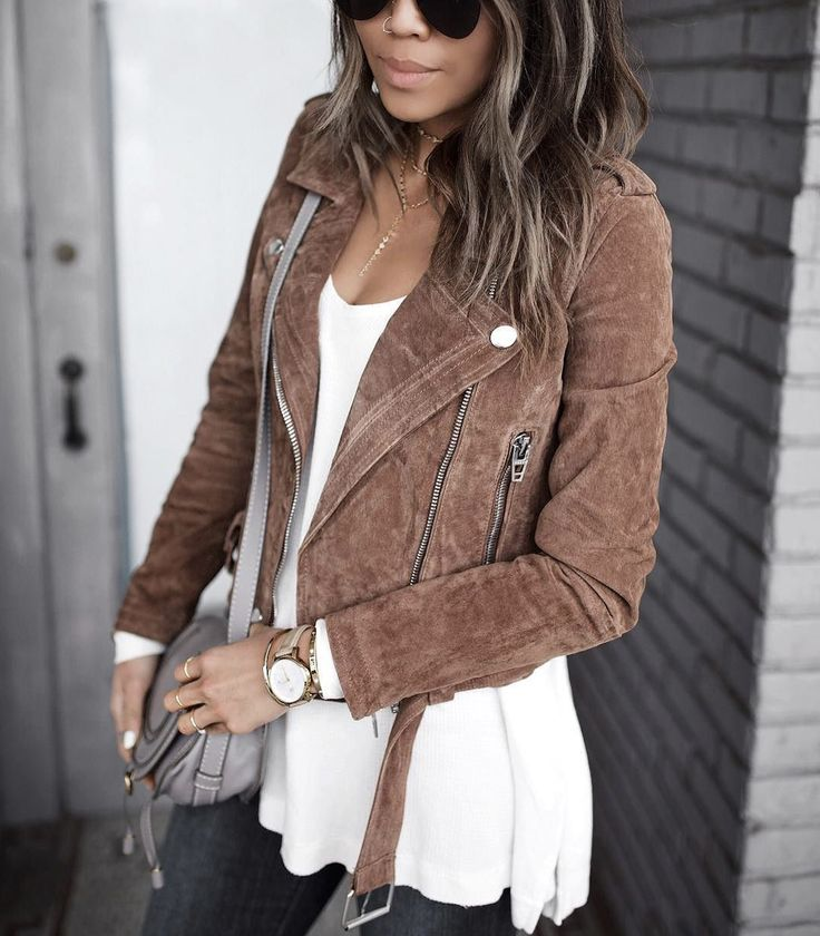 Tan suede leather jacket, white top, jeans
