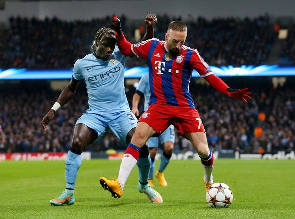 Franck Ribery of Bayern Muenchen is closed down by Bacary Sagna of Manchester City during the UEFA Champions League Group E match between Manchester City and FC Bayern Muenchen at the Etihad Stadium on November 25, 2014 in Manchester, United Kingdom.