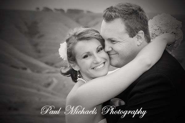Dan and cally in front of the rolling hills at Ohariu. Wellington wedding venue. Paul Michaels photography http://www.paulmichaels.co.nz/