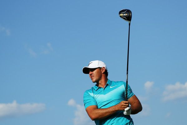 Brooks Koepka Photos Photos - Brooks Koepka of the United States plays his shot from the 16th tee during the third round of the TOUR Championship at East Lake Golf Club on September 23, 2017 in Atlanta, Georgia. - TOUR Championship - Round Three