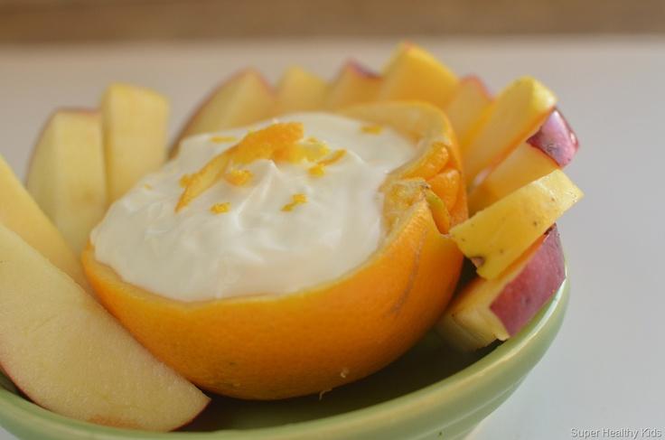 Fruit dip for kids served in an orange peel.