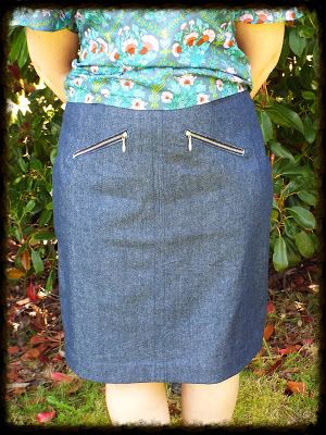 a straight denim skirt with zippered front pockets