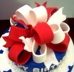 Edible gum paste ribbon bow cake topper by CherisSweets on Etsy.  Beautiful addition to any cake!
